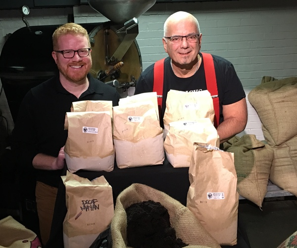 City Councilor Matt O039Malley and JP Licks FounderOwner Vincent Petryk in front of coffee roaster and behind bags of coffee grounds for composting